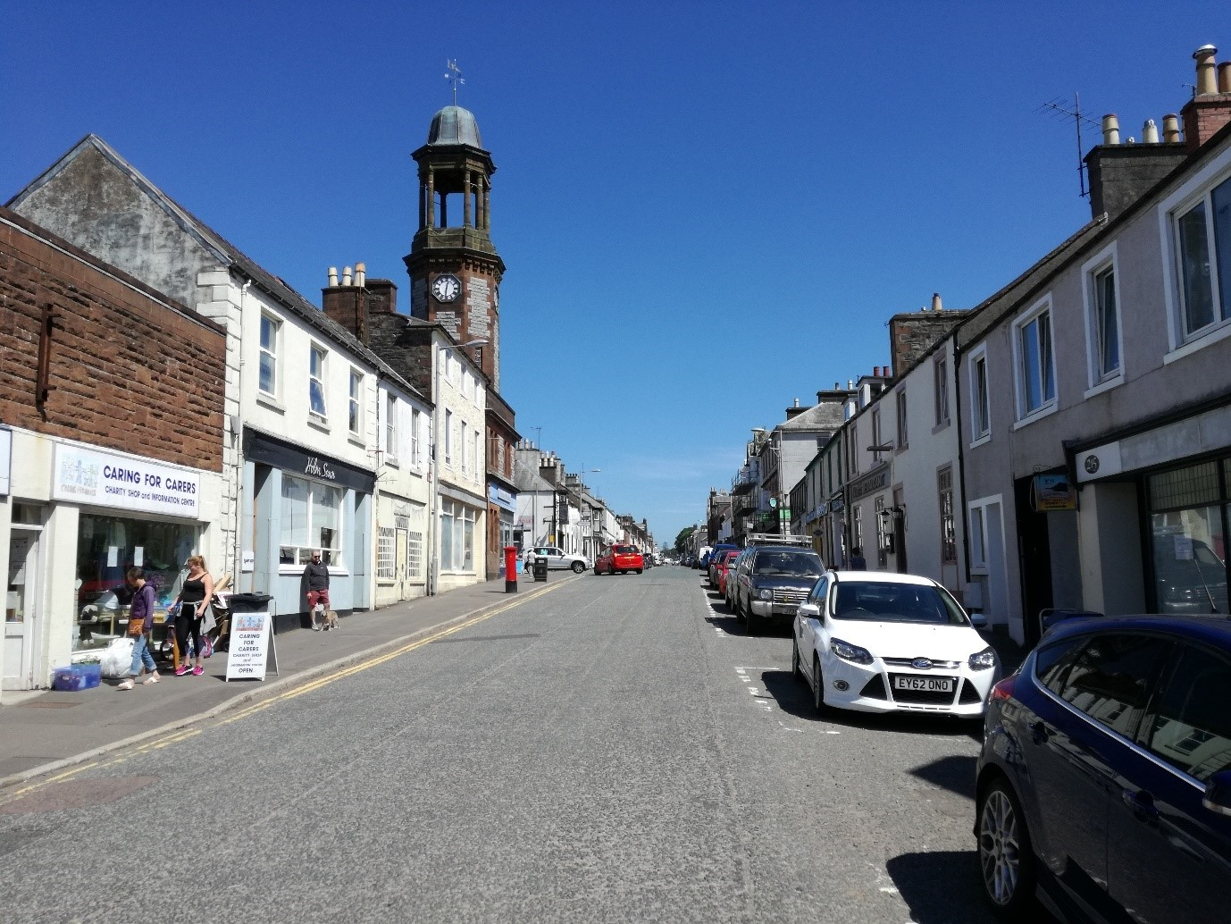 Photo of a sunny Scottish high street road