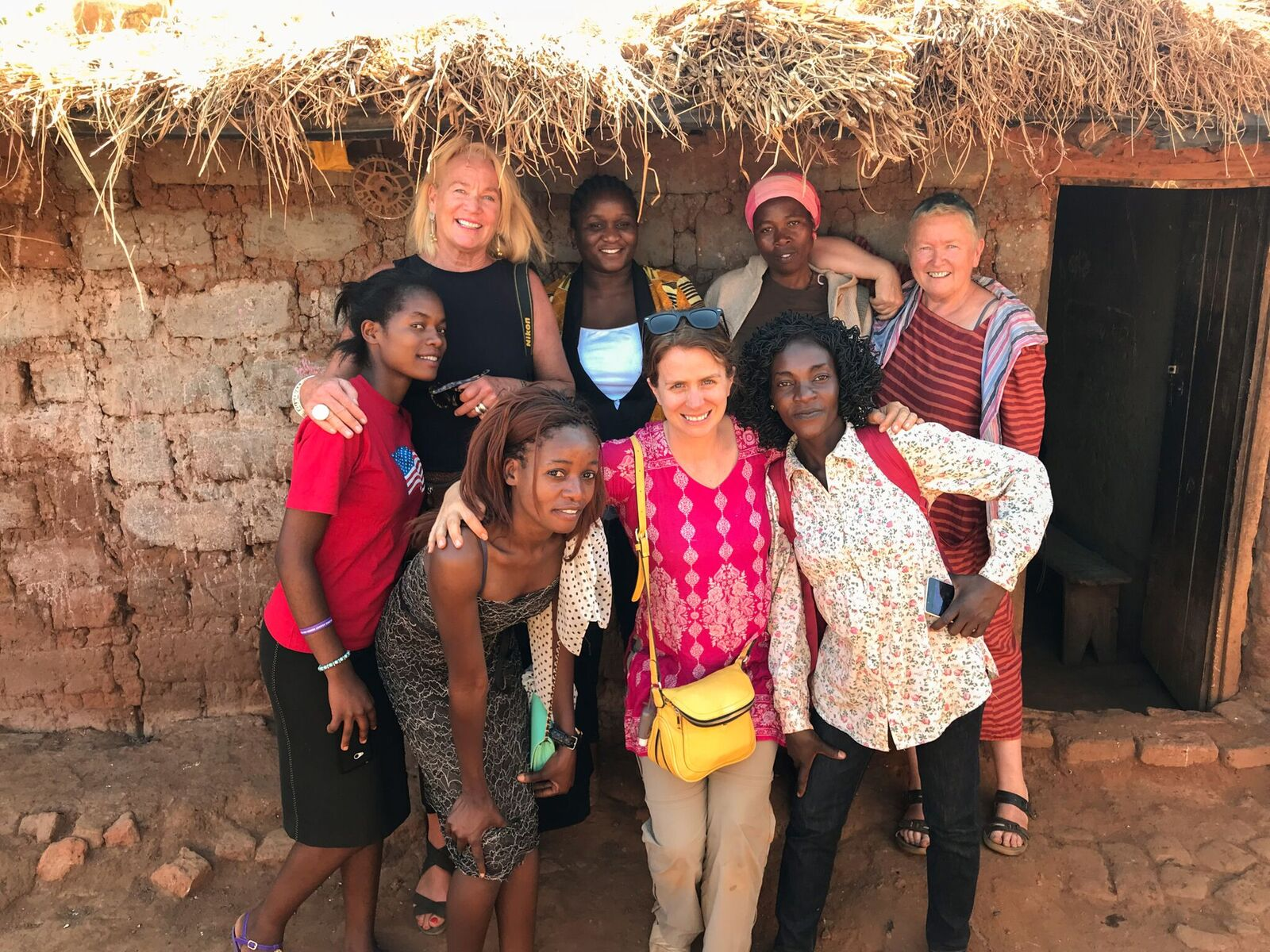 Lauren Anders Brown and Janie Hampton with women in Malawi